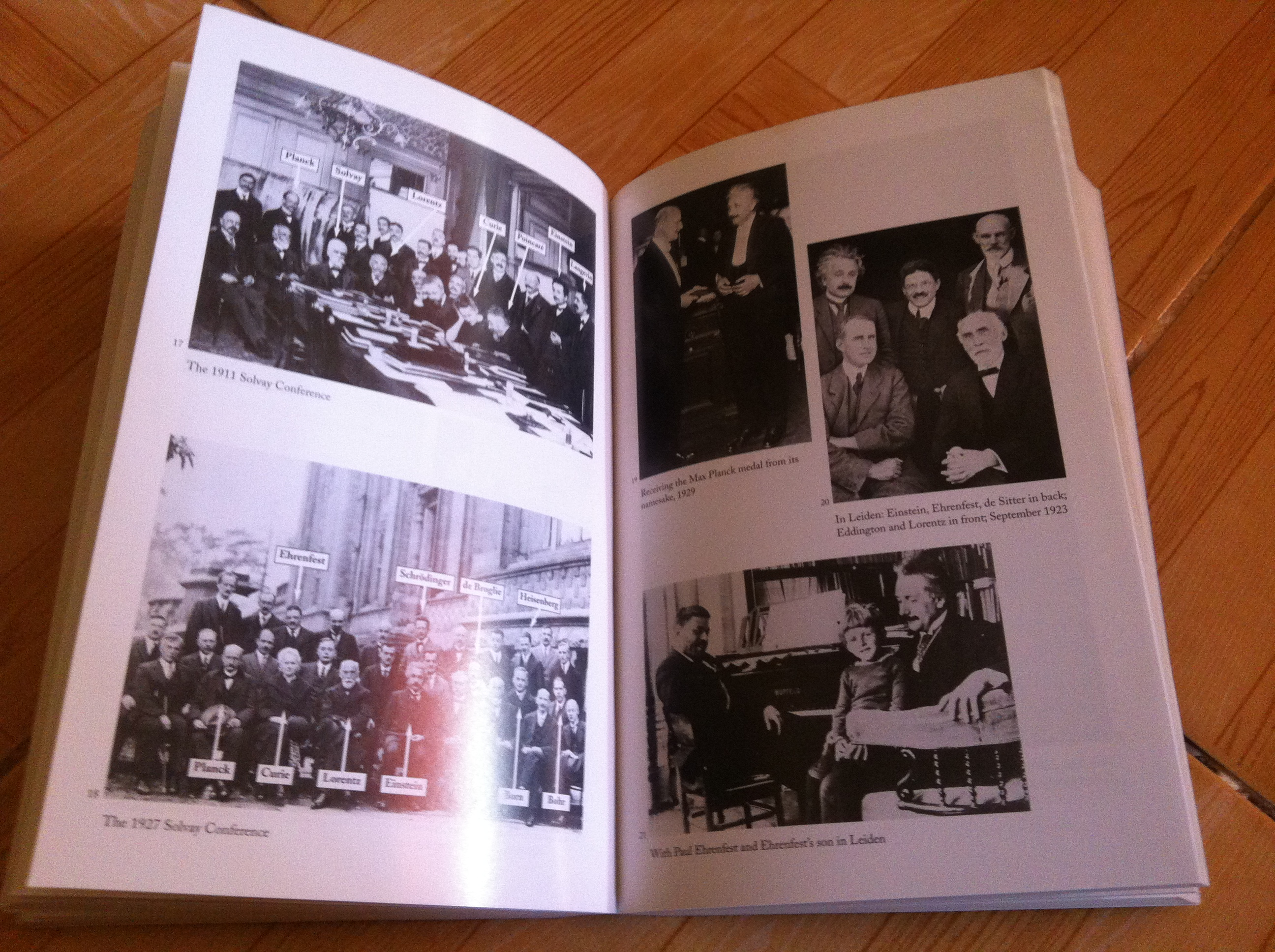 Photos of Einstein in one of several pages full of his photographic life: His Life and Universe by Isaacson Walter
