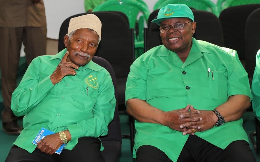 Former Presidents Ali Hassan Mwinyi(left) and his successor Benjamin Mkapa follow proceedings on 11th July 2015 in Dodoma